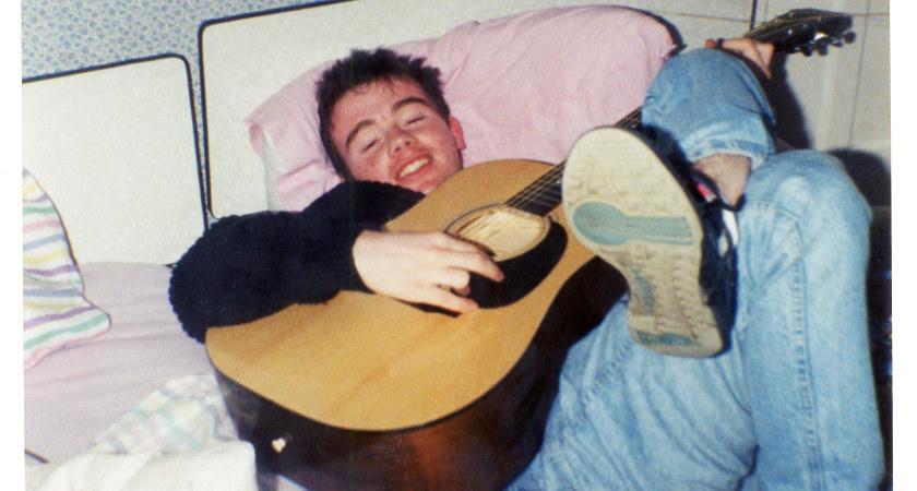Adrian Doherty playing guitar